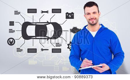 Male mechanic writing on clipboard against grey vignette