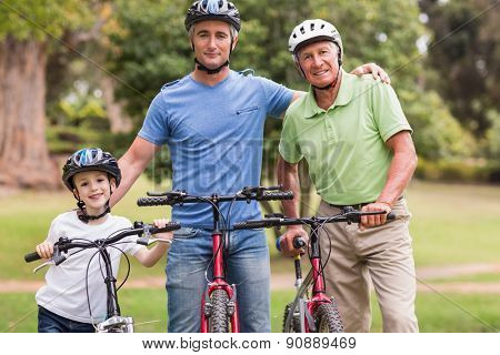 Happy multi generation family on their bike at the park on a sunny day