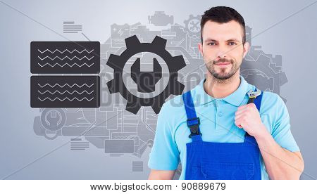 Repairman holding adjustable wrench against grey vignette