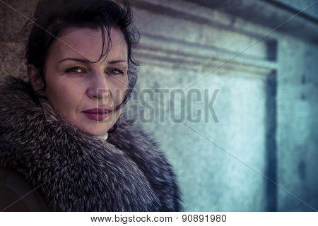 Russian woman in fur coat in a park in autumn