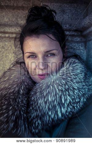 Winter, Russian woman in fur coat in a park in autumn