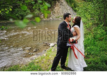 Wedding Couple Near The Shallow River