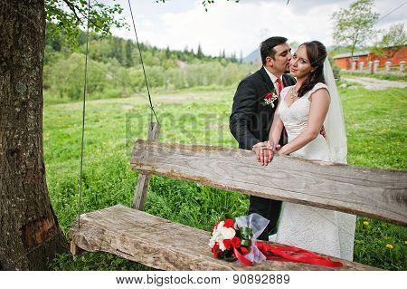 Wedding Couple Near Wooden Swing
