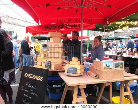 Unidentified Visitors Near A Swiss Cheese Stall At Borough Market On August 14, 2010 In London