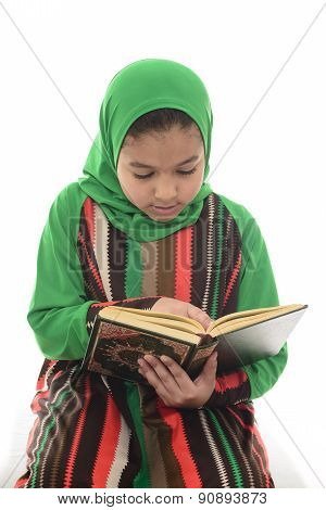 Little Young Muslim Girl Reading Book Of Quran