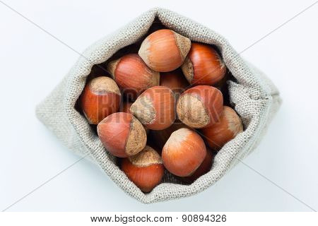 Hazelnuts in the linen bag isolated