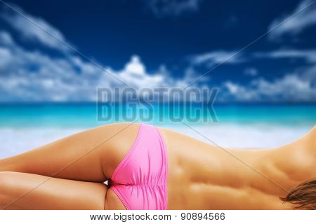 Woman topless on beautiful beach Anse Intendance at Seychelles. Collage.