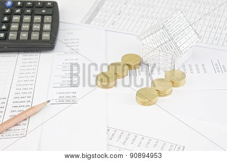Pencil House And Gold Coins