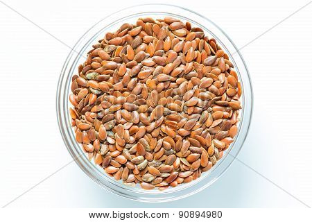 Flax seeds in the glass bowl isolated