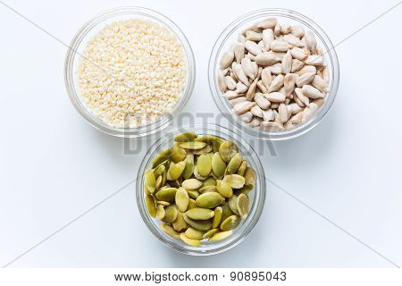 Pumpkin, sunflower, and sesame seeds in the glass bowls