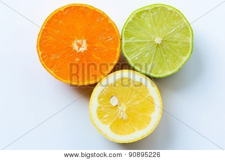 Mandarin, lemon, and green lime slices isolated on white background