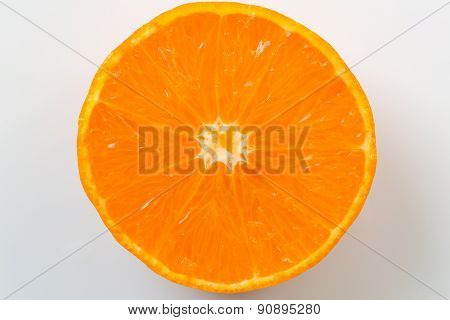 Slice of mandarin isolated on white background
