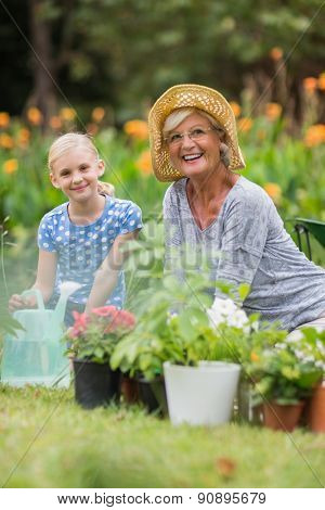 Happy grandmother and grandfather gardening on a sunny day
