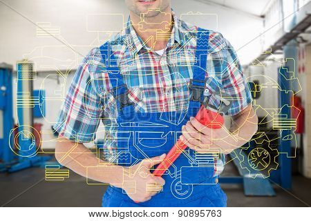 Cropped image of plumber holding monkey wrench against empty work stations