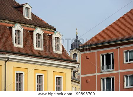 Bell Tower Of Frauenkirche In Gap Between Buildings In Dresden.