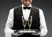 picture of flute  - butler with two champagne flute on tray - JPG
