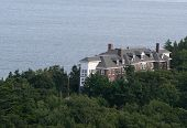 picture of acadian  - a seaside mansion peaking out of the acadian forest - JPG