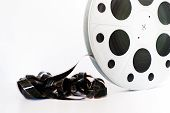 stock photo of mm  - Vintage 35 mm movie cinema reel on white background film unrolled and copy space - JPG