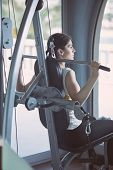 stock photo of pull up  - Woman weight training at gym - JPG