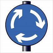 picture of traffic sign  - A large round blue traffic sign displaying traffic island arrows - JPG