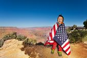 pic of bundle  - Happy small boy who is bundled up into American flag with Grand Canyon National Park view - JPG