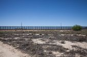 stock photo of smuggling  - The border fence near El Paso - JPG