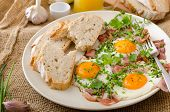 stock photo of redneck  - Spring omelette with bacon egg and herbs homemade rustical bread - JPG