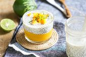 stock photo of mango  - Chia in homemade soy milk with mango puree and mango chunk - JPG