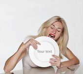 stock photo of licking  - Blond woman licking white plate - JPG