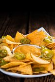 stock photo of nachos  - Nachos with Cheese Dip  - JPG