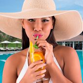 picture of filipina  - Portrait of beautiful Asian woman in a hat drinking cocktail - JPG