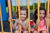 pic of little sister  - Portrait of two little sisters on the playground - JPG