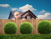 picture of wooden fence  - a nosey neighbor man looking over fence - JPG