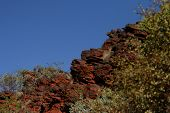 image of iron ore  - Glowing red rock face and bush at sunset near Mount Nameless in Tom Price - JPG