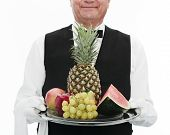 foto of fruit platter  - butler holding tray with assortment of fruits - JPG