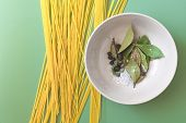 stock photo of salt-bowl  - Spaghetti And Bowl With Bay Leaves - JPG