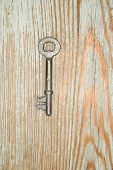 picture of hasp  - Vintage key from the lock on a wooden texture - JPG