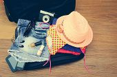 pic of denim jeans  - Open the suitcase with tourist things - JPG