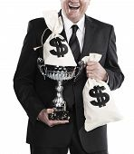 picture of money prize  - cheerful businessman holding trophy and money bags isolated on a white background - JPG