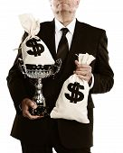 picture of money prize  - businessman holding trophy and money bags isolated on a white background - JPG