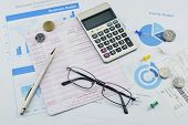 image of graph paper  - Glasses pen calculator and coin on graph paper saving concept - JPG