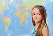 picture of geography  - Young girl in front of world map  - JPG