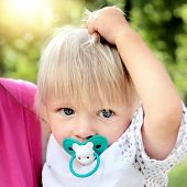stock photo of teats  - Baby Boy Portrait in the Summer Park - JPG