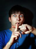 image of scared  - Scared Teenager in the Dark Room with Crossed Fingers - JPG