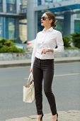 stock photo of shiting  - Stylish business woman in the big city - JPG