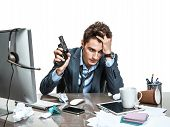 foto of suicide  - Young office man with gun wants to commit suicide  - JPG