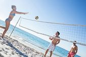 foto of volleyball  - Friends playing volleyball at the beach - JPG