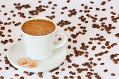 foto of sugar cube  - Fresh brewed coffee mug with sugar cubes and coffee beans on background - JPG