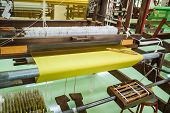foto of silk worm  - Ancient Silk weaving machines seen in rural Thailand - JPG