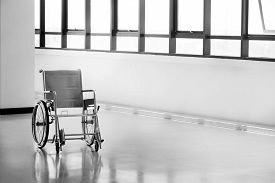 picture of wheelchair  - Empty wheelchair parked in hospital hallway - JPG